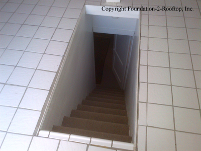 Missing handrail, missing railing, slippery tile floor, stairs aren't uniform.  Finish an attic right!